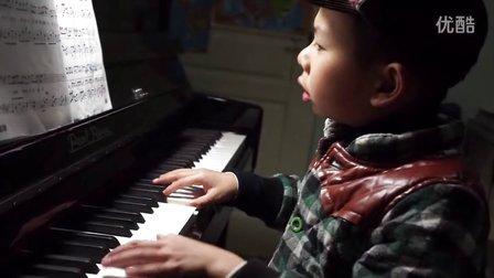 6岁男孩弹唱周董夜曲不容易啊